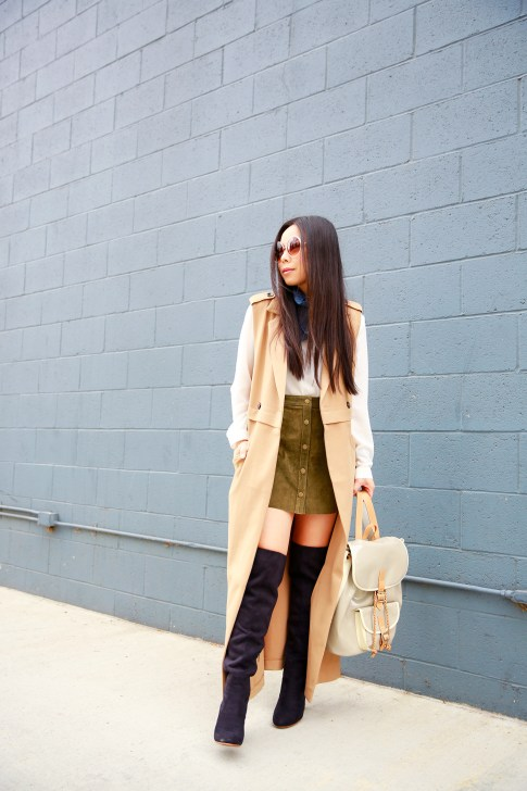 An Dyer wearing Hermes Scarf Around Neck, Olive Suede Button Front Skirt Sleeveless Trench Duster, JustFab suede Audenne Over The Knee Boots