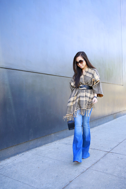 An Dyer wearing Hudson Mia Flared Jeans, Tom Ford Carrie, Morning Lavender Poncho with Marciano Belt