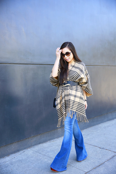 An Dyer wearing Hudson Mia Flared Jeans, Tom Ford Carrie, Morning Lavender Poncho with Marciano Belt and Chanel Boy Bag