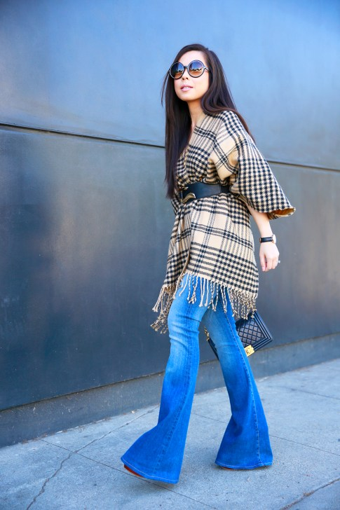 An Dyer wearing Hudson Mia Flares, Tom Ford Carrie, Morning Lavender Poncho with Marciano Belt and Chanel Boy Bag