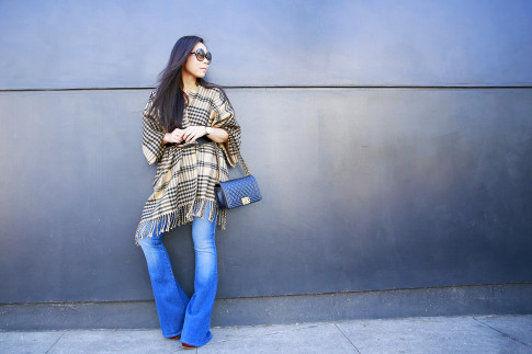 An Dyer wearing Morning Lavender Poncho, Hudson Mia Flares and Chanel Boy Bag
