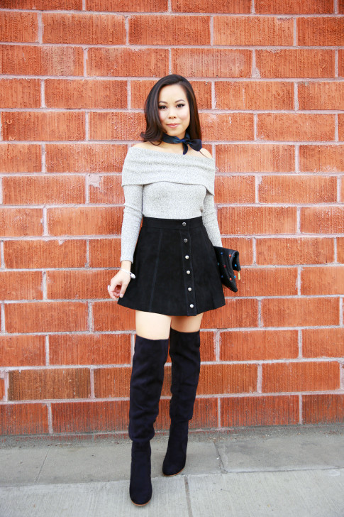 An Dyer wearing Hermes Neck Scarf, Grey Off the Shoulder Sweater Suede Button Front Skirt OTK Boots