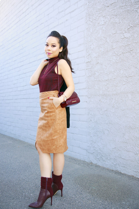An Dyer wearing RD Style Top, House of CB Skirt, Guess Boots