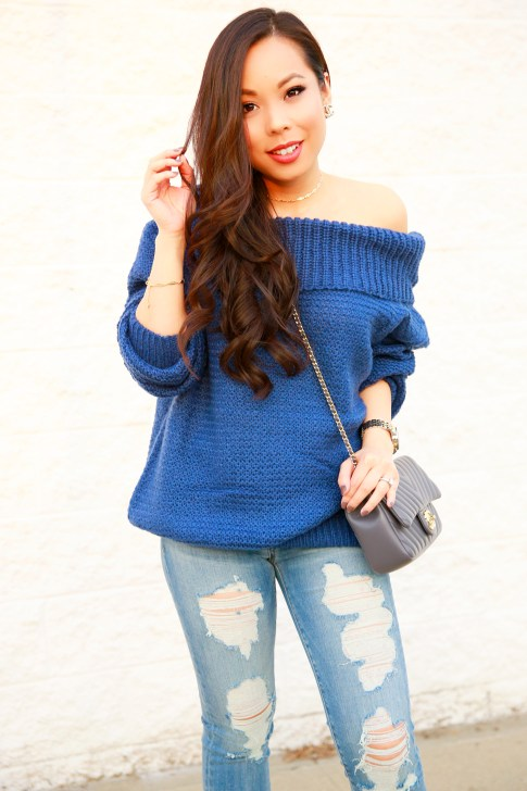 An Dyer wearing Chicwish Marine Blue Off The Shoulder Chunky Knit Sweater