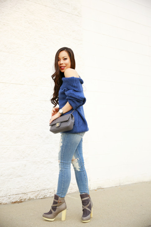 An Dyer wearing Marine Blue Chic Wish Off The Shoulder Sweater with Fidelity Distressed Jeans & ALC Boots