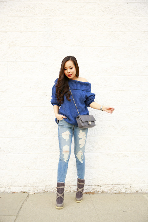 An Dyer wearing Marine Blue Chicwish Off The Shoulder Sweater with Fidelity Distressed Jeans & Australian Luxe Collective Boots