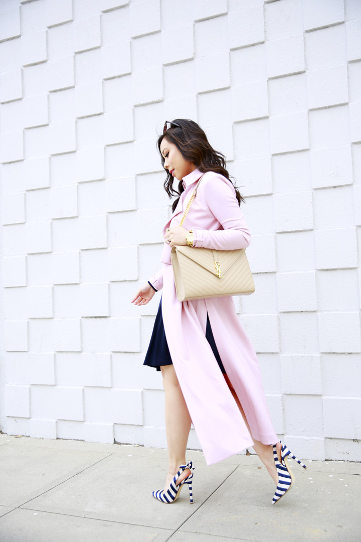 An Dyer wearing Blush Pink Duster Coat and Navy Stripe Bow Slingback Pumps