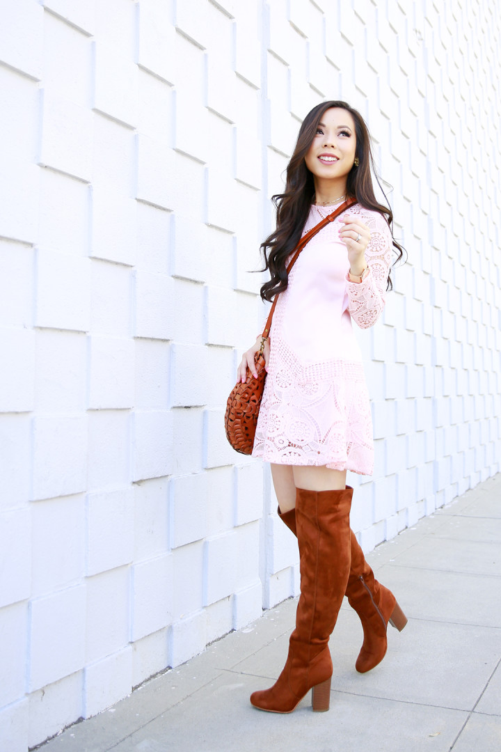 An Dyer wearing Chicwish Pink Blush Crochet Dress with Justfab Cognac Over The Knee Boots