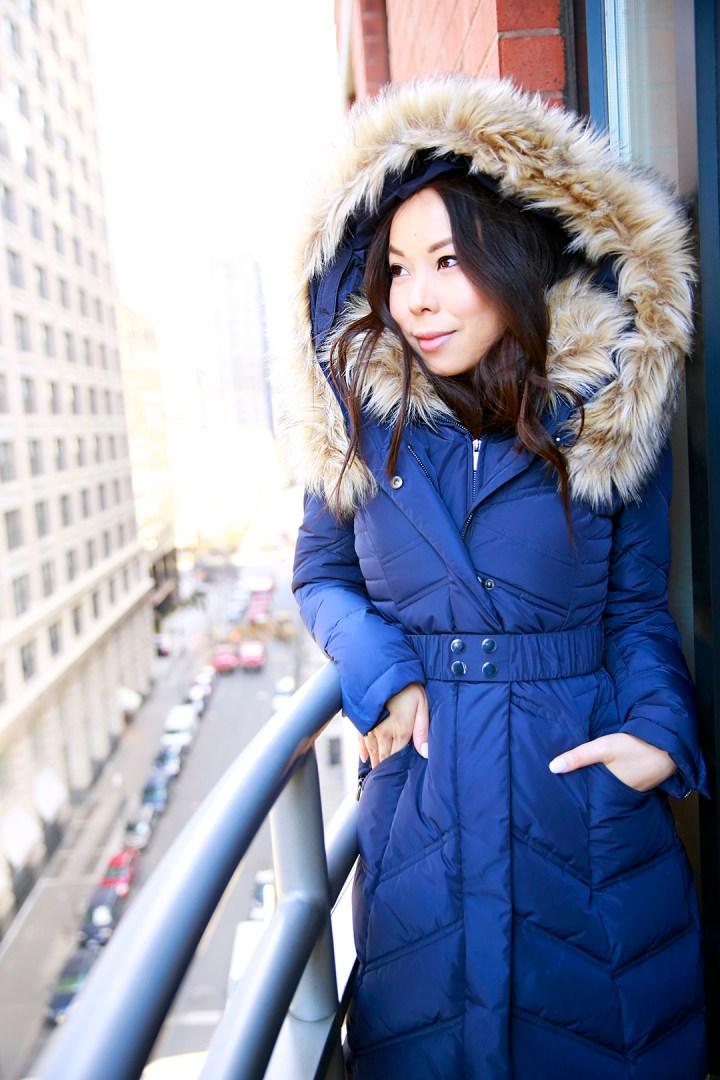 An Dyer wearing Guess faux fur coat
