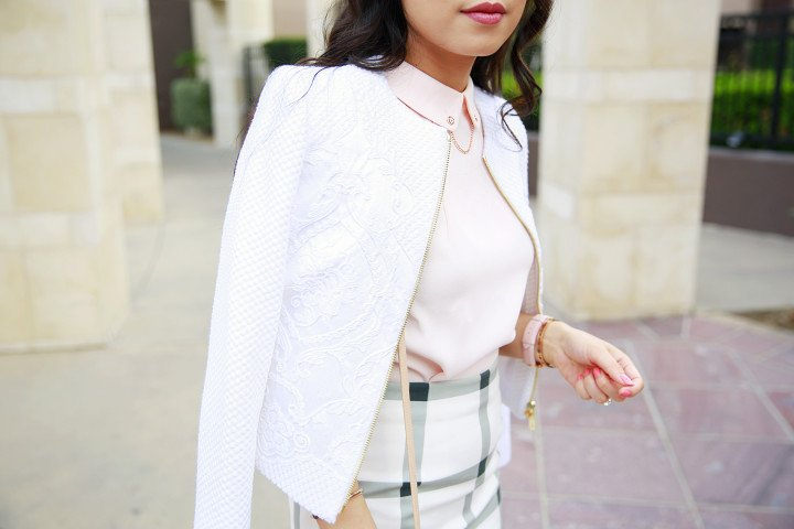 An Dyer wearing Ted Baker LUA Jacquard cropped jacket and GURRA Chain detail collared top
