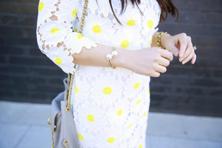 An Dyer wearing Charming Charlie Pearl Bracelet Cuff