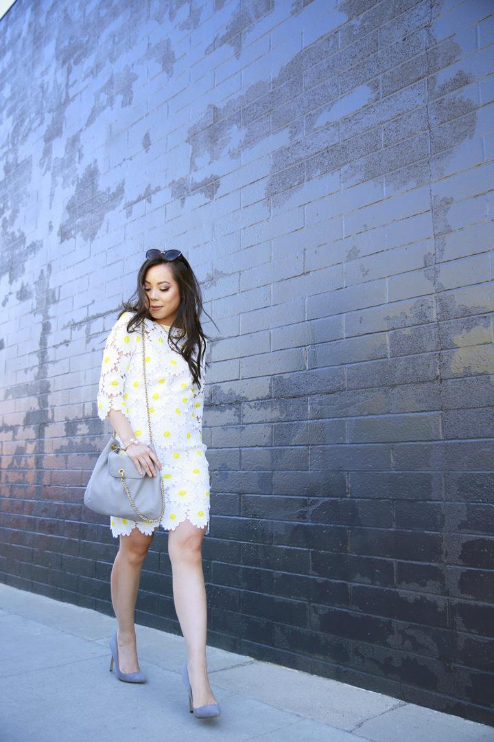 An Dyer wearing Chicwish Crochet Daisy Dress & SJP Collection Chelsea Bag