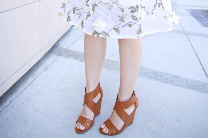 An Dyer wearing Camel Cognac Tan Cross Front Wedge Sandals