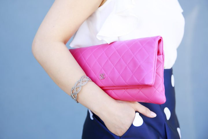 An Dyer wearing Chanel Hot Pink Quilted Foldover Clutch