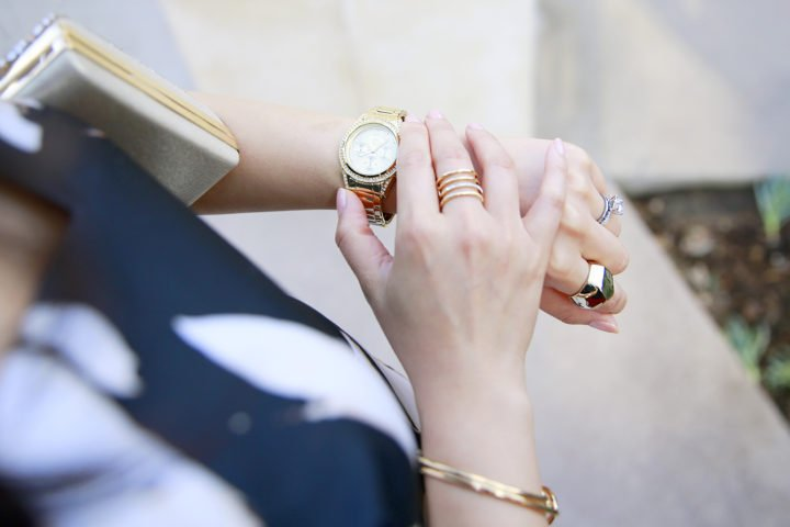 An Dyer wearing Charming Charlie Gold Cuff Watch