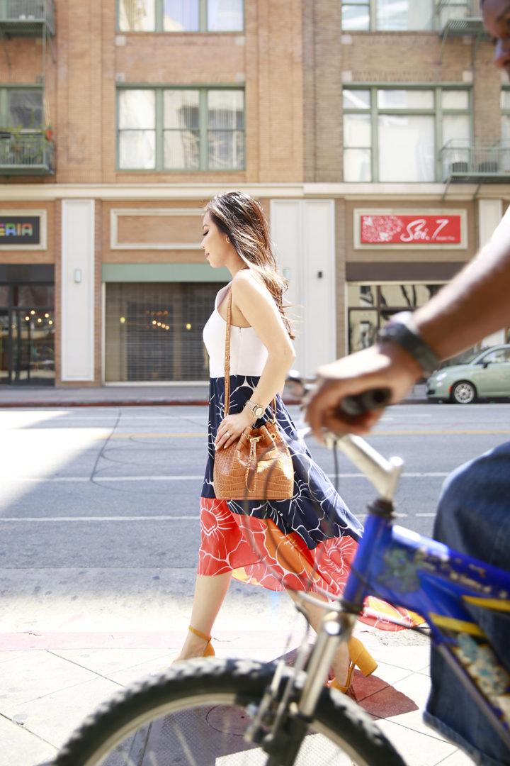 An Dyer wearing Hutch Dress with Brahmin Maxine Bucket Bag