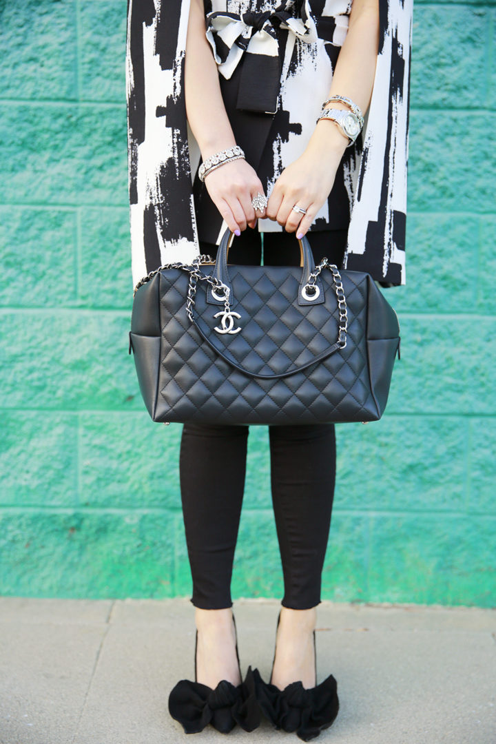 An Dyer carrying Chanel Two Tone Color Block Bowler Bowling Bag