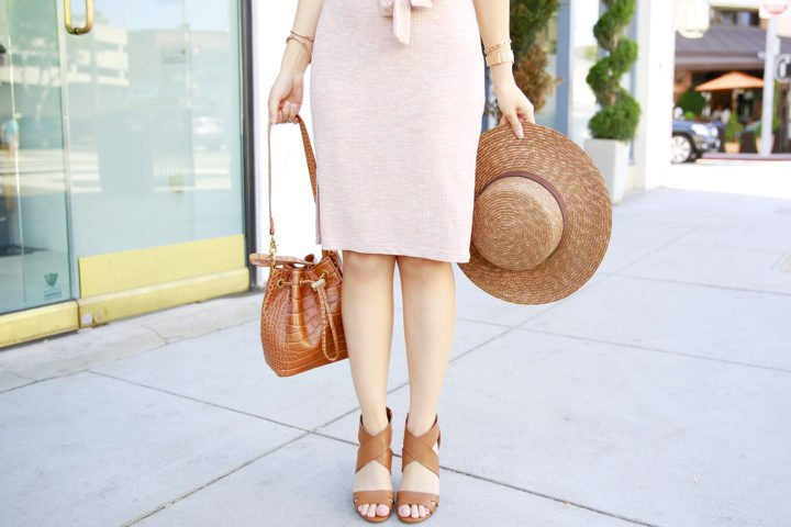 An Dyer wearing Brahmin Southcoast Maxine Bucket Bag