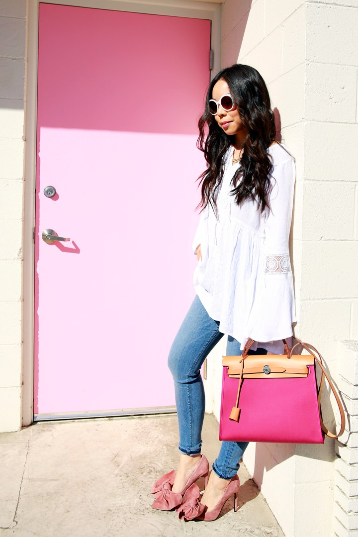 An Dyer wearing Hermes Herbag Rose with Hudson Jeans and Jeffrey Campbell Grandame