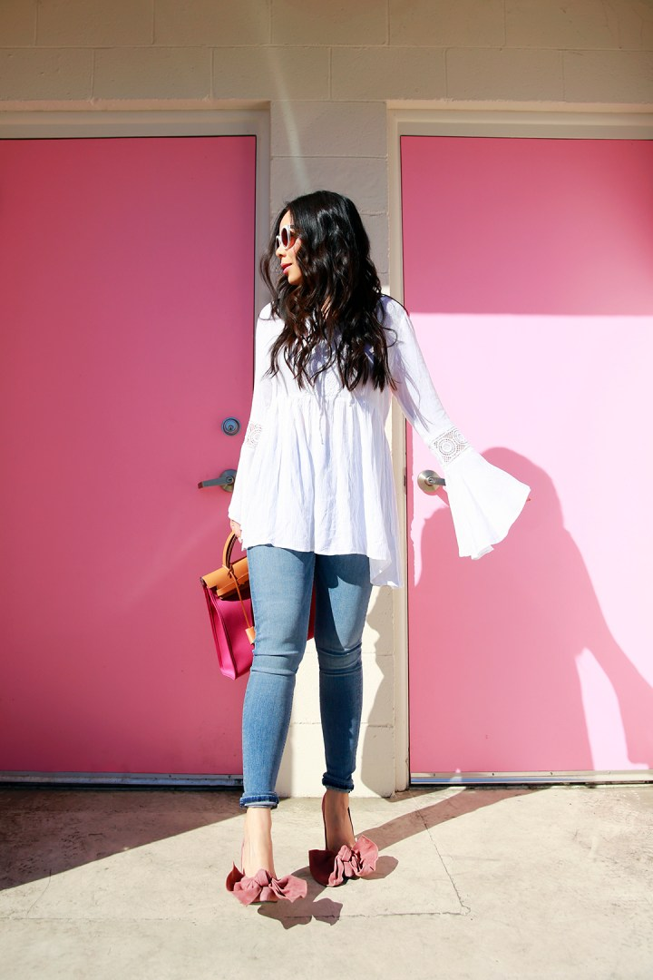 An Dyer wearing Jeffrey Campbell Grandame Suede Bow Pump - Dusty Rose with Charming Charlie Boho White Blouse Top