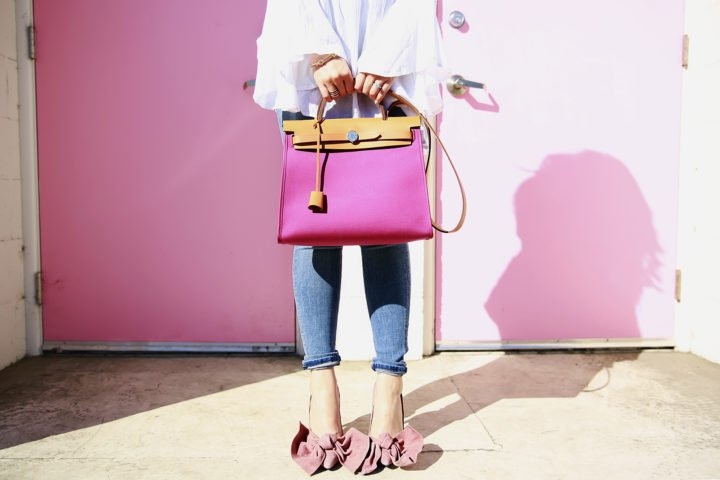 An Dyer wearing Jeffrey Campbell Grandame and Hermes Herbag Rose Pink