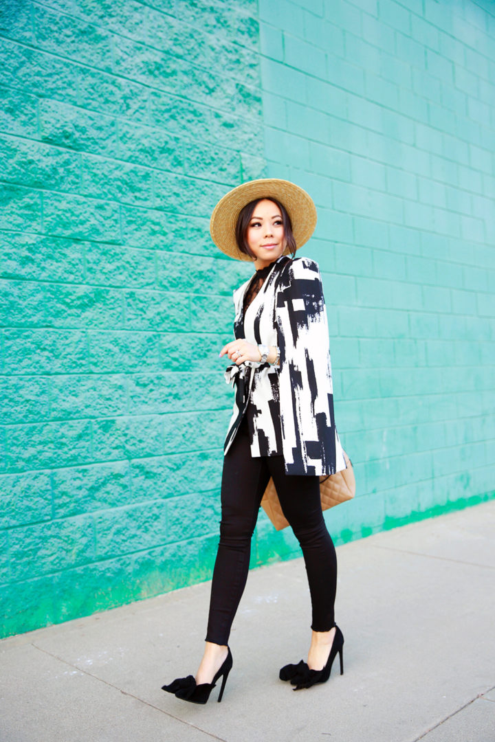 An Dyer wearing Lavish Alice Cape with Mott and Bow Black Jeans