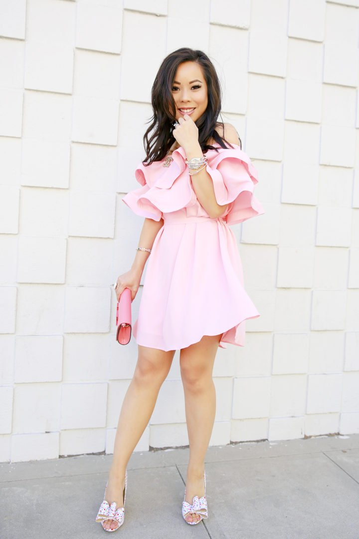 An Dyer wearing Pink Ruffled Off Shoulder Chicwish Dress with Chanel Brooch