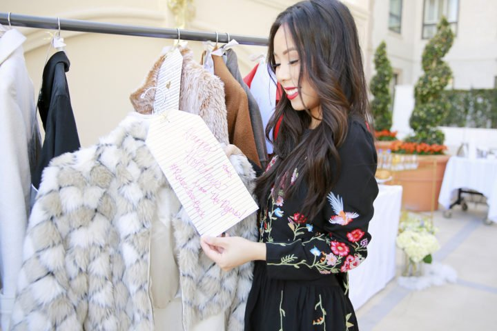an-dyer-donating-coats-at-rodeo-gives-back-salvation-army-donation-blogger-influencer-event