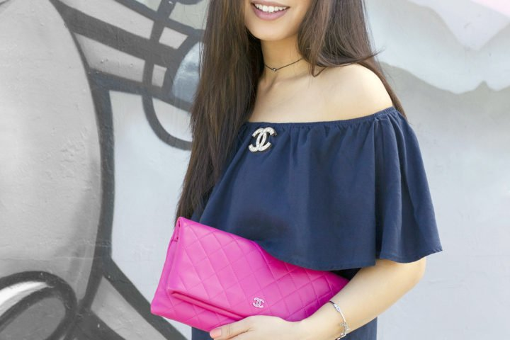 an-dyer-wearing-my-jewel-bar-choker-with-chanel-brooch-and-pink-quilted-clutch
