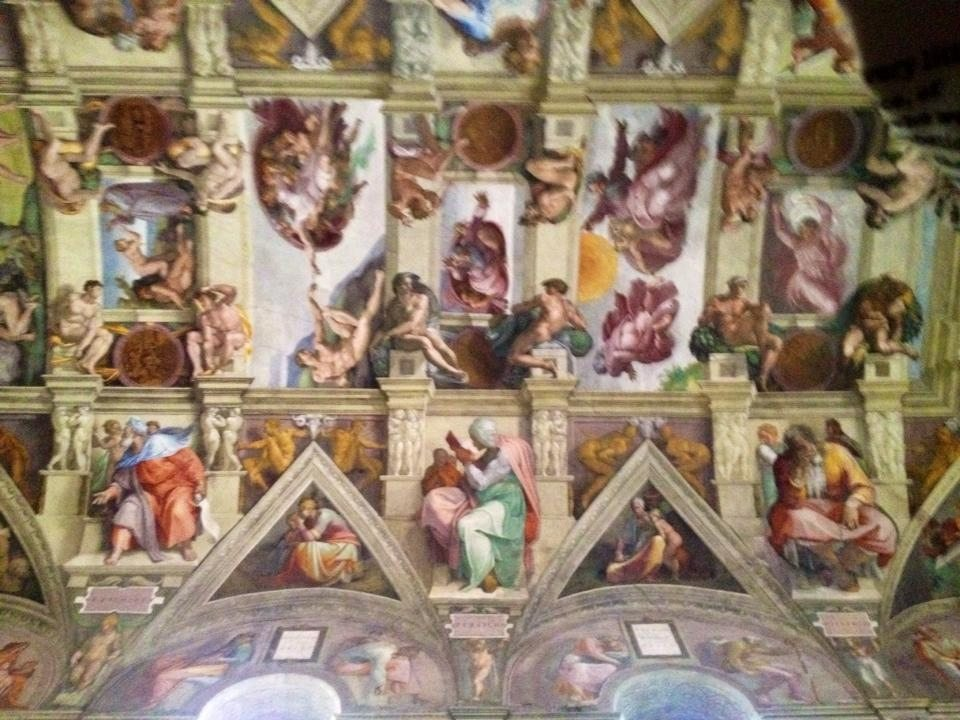 We did snap a couple sneaky pictures inside the Sistine Chapel. I managed to get The Creation of Adam in this one.