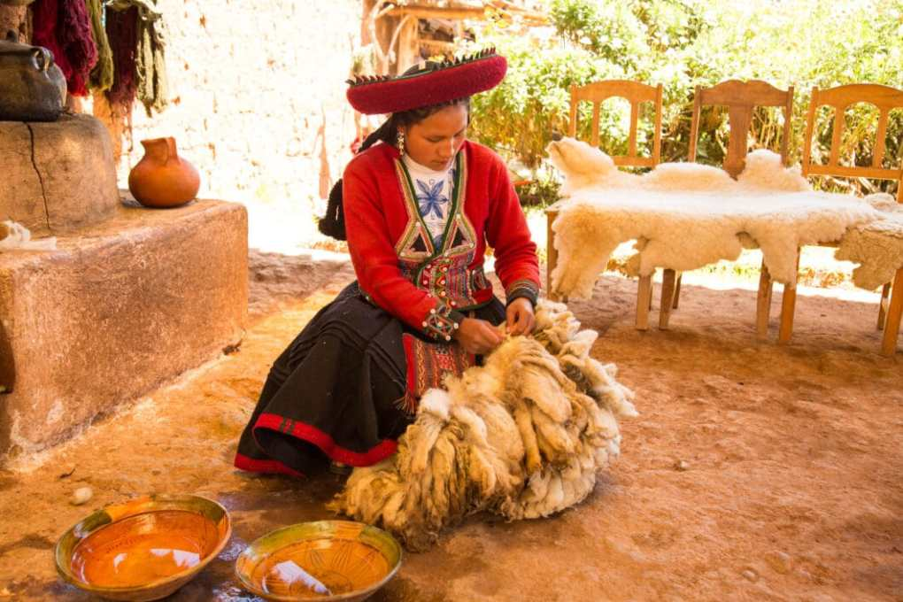 Demonstrating how they wash the wool.