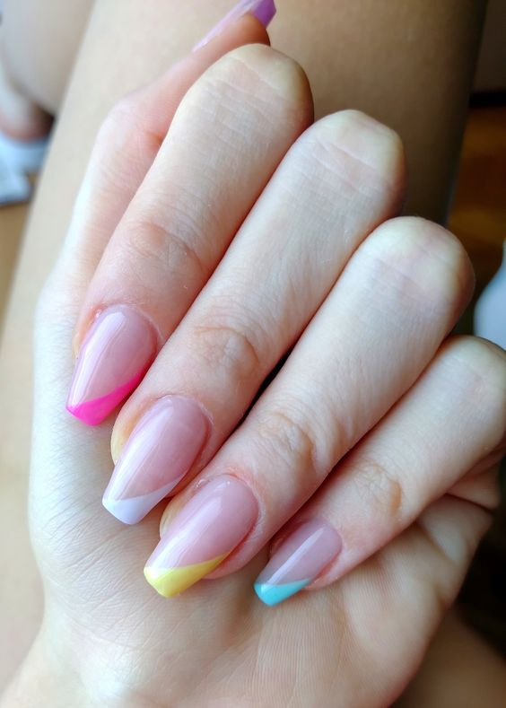Asymmetrical tip manicure perfect for spring and summer