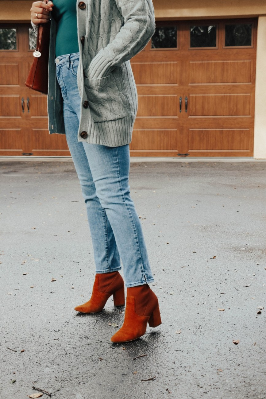 Winter outfit ideas wearing a cable knit cardigan and jeans. #outfitideas #winteroutfit