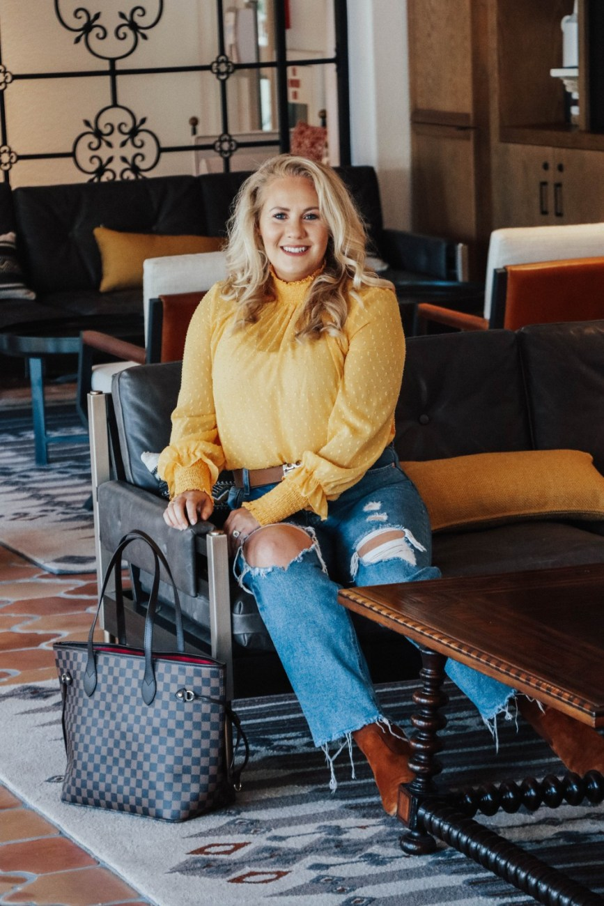 Wearing a marigold blouse with distressed denim, cognac suede boots, and my Tory Burch reversible belt. #falloutfit #fallcolortrend #falloutfitinspo