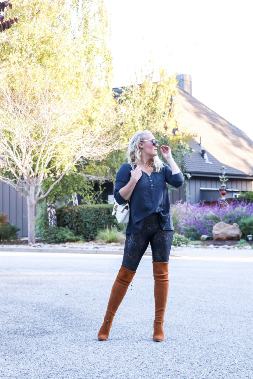 Easy everyday outfit for fall wearing a thermal top, leopard print leggings, and over the knee boots. #fallstyle #casualoutfit #falloutfit