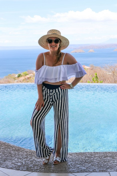 Sharing a poolside look + some of the best swimsuit coverup pants on Have Need Want! Click on the photo to check out the post + get product details!! #summerstyle #swimwear #coverup #beachcoverup #isabellarose #vacationstyle