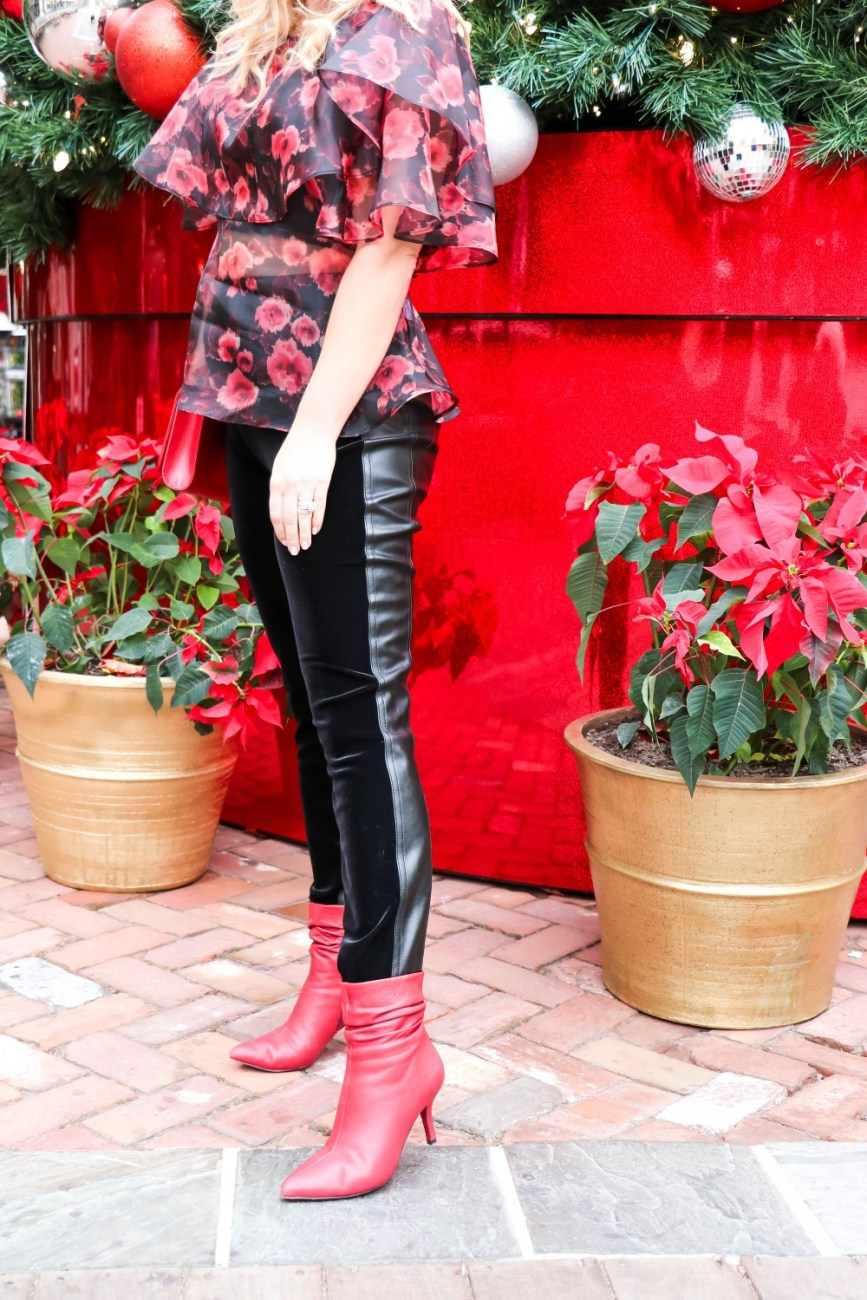The perfect holiday party outfit wearing Topshop sheer floral organza blouse with velvet and faux leather leggings and red leather booties. #holidayoutfit #topshop #sheertop #floralorganzatop