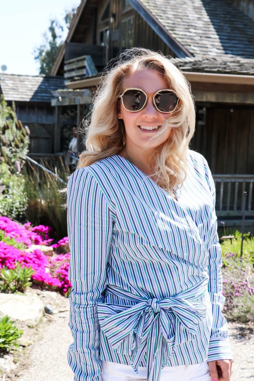 Sharing a great Spring transition outfit on the blog today. Head on over to the post to check out the full look + get outfit details! #springstyle #springoutfit #wrapblouse #denimshorts #whitedenim #outfitinspiration