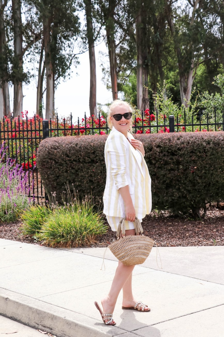 Wearing one of summer's biggest trends, a matching linen blazer and linen shorts. I love the soft subtle stripe and how effortless this look feels. Head over to the post to check it out plus find out where you can buy these coordinating separates on sale! #linenblazer #linenshorts #framedenim #summeroutfit #summerstyle #casualoutfit