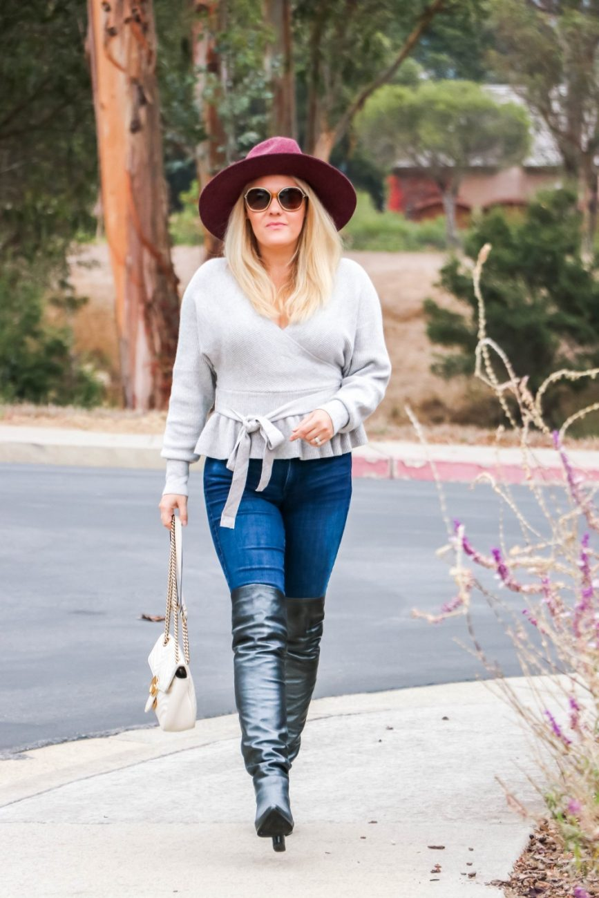 The peplum sweater you need this winter! Perfect paring with jeans and boots. Head to the post to check out the full look + get outfit details! #winterstyle #falloutfitinspo #falloutfit #peplumsweater #overthekneeboots