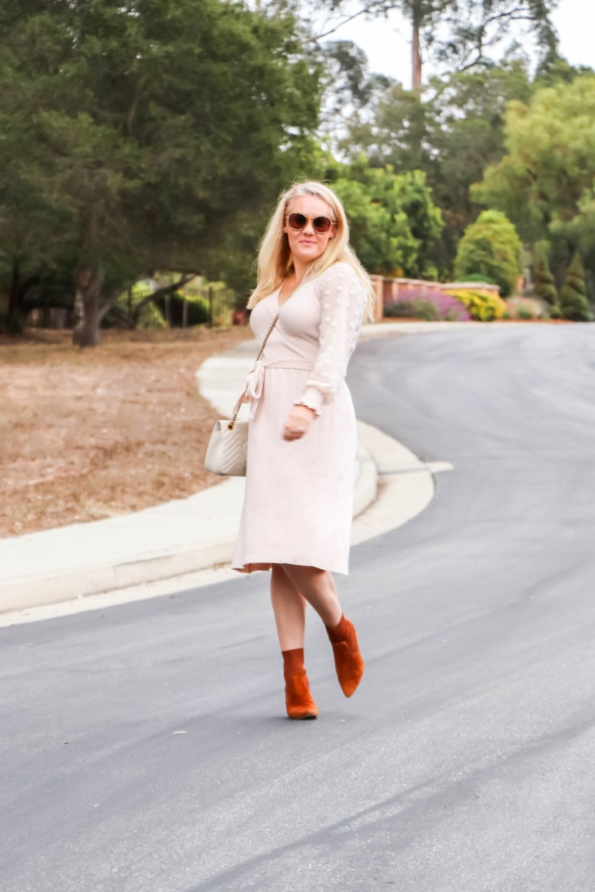 Pleated sweater dress paired with suede sock booties for a Thanksgiving outfit option. #thanksgiving #sweaterdress #under30dress #thanksgivingstyle