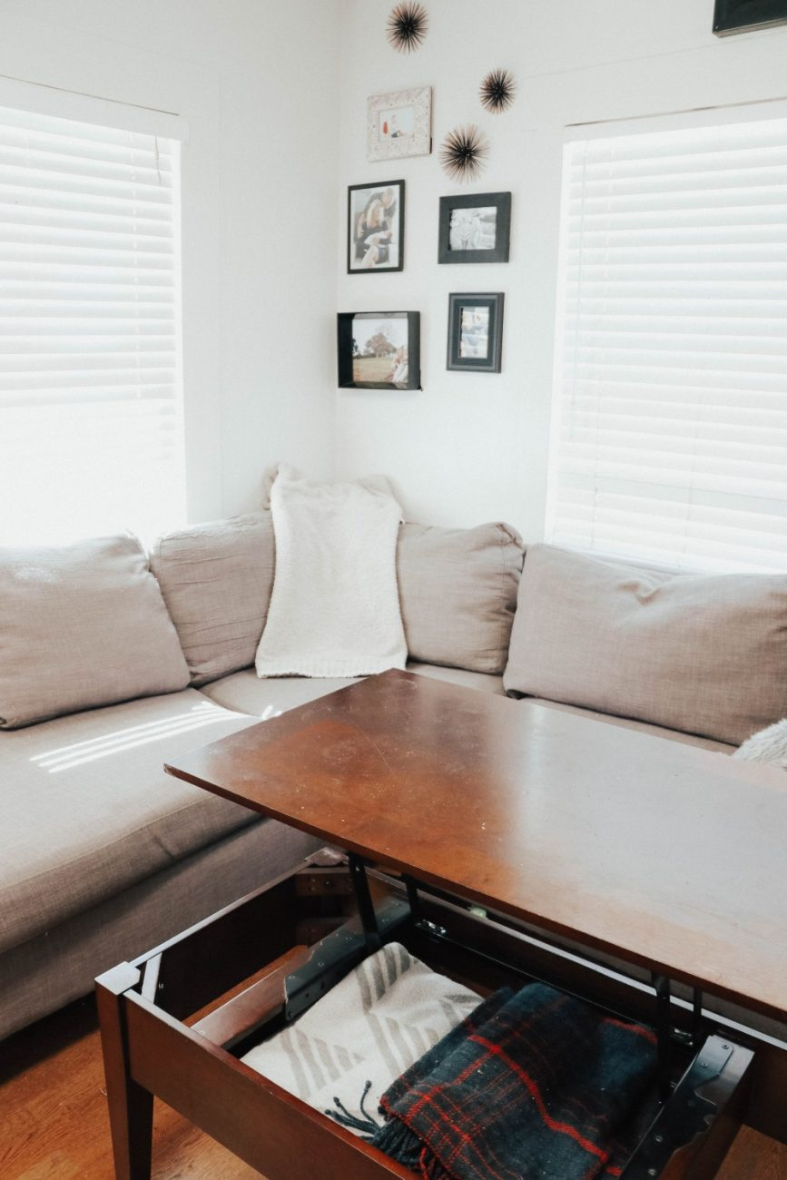 If you're needing extra storage space in your living room a pull up coffee table is a discreet option. Get more storage solutions on todays blog post! #homestorage #storagecoffeetable #livingroomstorage