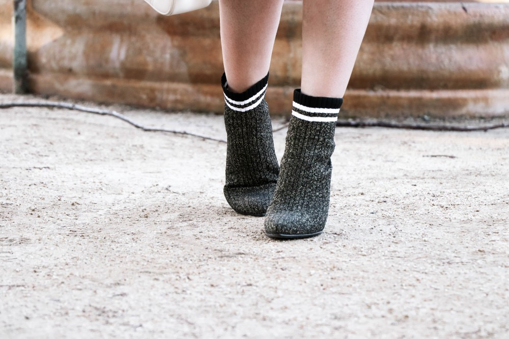 Varsity Style Wearing Fuzzy Bomber Jacket and Stripe Sock Booties | Have Need Want #varsitystyle #bomberjacket #sockbooties #casualstyle #stuartweitzman