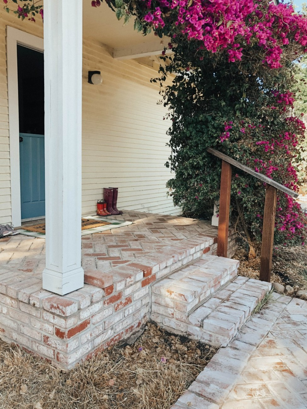 Sharing a quick and easy DIY project that can be done in a weekend! Whitewashing brick is a project that makes a huge impact with minimal effort. Click on over to the post to check out what you'll need and the steps to take. #diyproject #whitewashingbrick #whitewashedbrick #brickwalkway