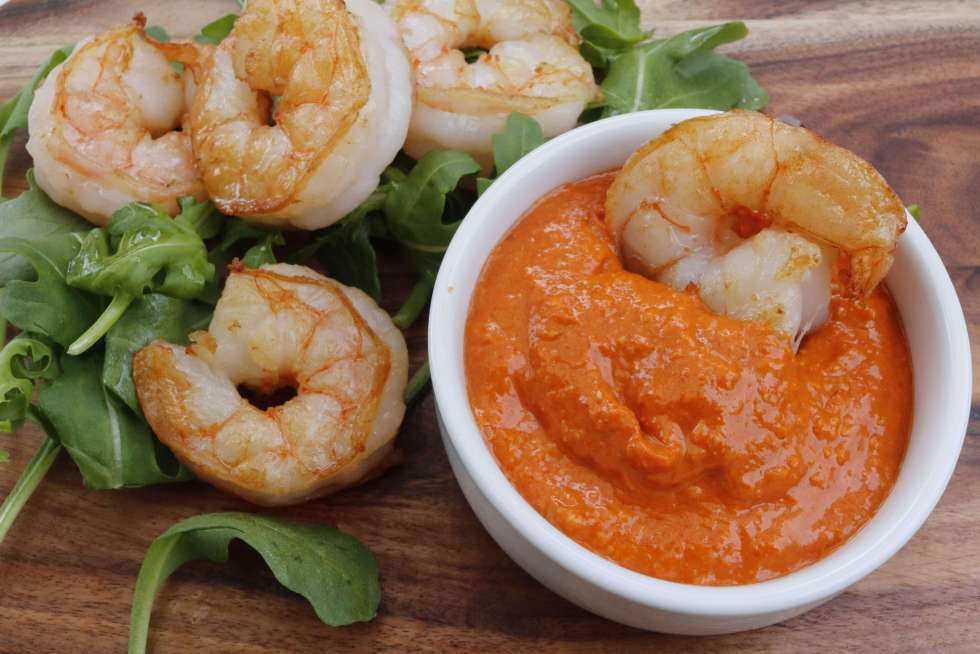 Romesco sauce is a delicious red pepper and nut sauce that originated in Spain. This smoky remoesco sauce is a really tasty keto, dairy free sauce that is great with seafood. At 1 net carb per serve it's a wonderful low carb option to add to your meal.