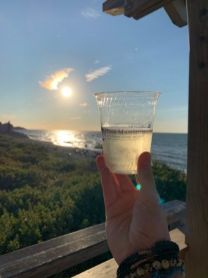Glass of Champagne watching the Sunset from the Beach Bar