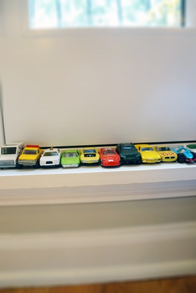 Baby boys' race cars on the ledge