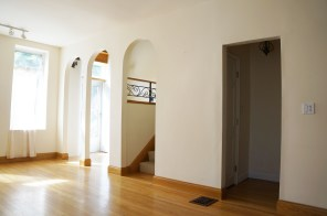 Existing living room {existing arched doorways and future opening to basement}