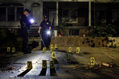 Crime Scene Unit members gather evidence from a sidewalk on Saul Street near Bridge Street in the Frankford section of Philadelphia, Saturday Sept. 29, 2012, after a man was shot several times. Police said the man was wounded in the chest and legs and was in very critical condition. Photograph by Joseph Kaczmarek for the Gun Crisis Reporting Project.