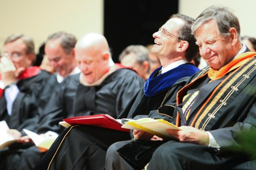 Weiss laughs Bryn Mawr College interim president Kimberly Wright Cassidy's remarks during his Inaugural Ceremony.